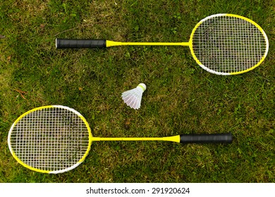 Badminton rackets on the green grass