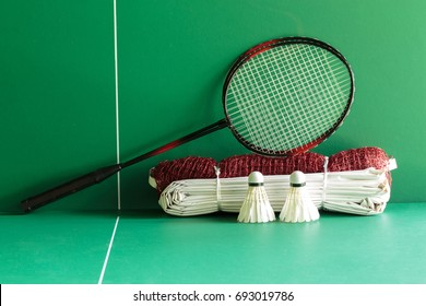 Badminton rackets , shuttercocks and net on the green table