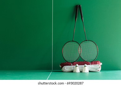 Badminton rackets ,shuttercocks  and net on the green table