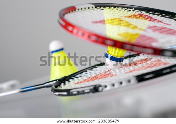 Badminton rackets and two shuttlecocks