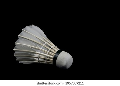 Badminton Shutter Cock isolated on Black Background. Healthy lifestyle and sport concept.