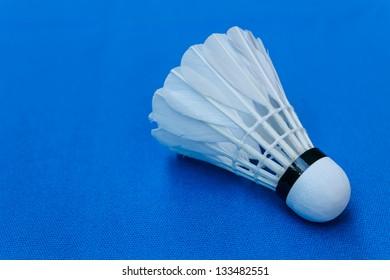 Badminton shuttercock on blue background