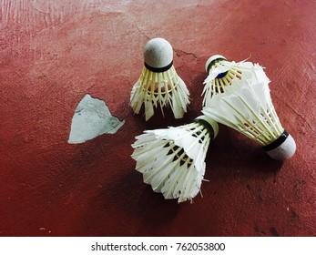 Badminton shuttercock on red colour floor