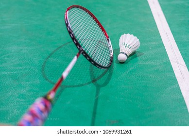 badminton shuttlecock and racket on court.