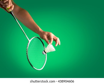 badminton sport in service action, racket with string and shuttlecock on player's hands