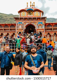 Badrinath, India - circa 2019 :- Indian man wearing scarf standing in front of the Badrinath Temple in Chamoli, Uttarakhand