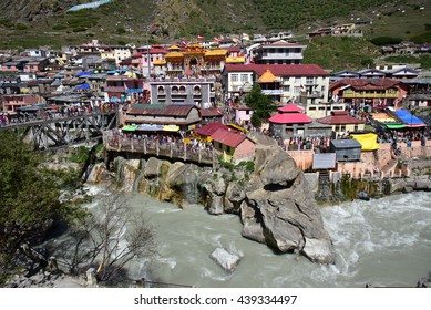 BADRINATH, UTTARAKHAND, INDIA, JUNE 01, 2016:  One of the most sacred and famous centres of pilgrimage in India, the Badrinath Vishnu temple. View from the other side of the Alakananda river.
