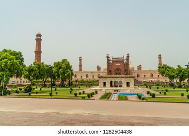 Badshahi Mosque with beautiful green gardens  in Lahore, Pakistan. Popular tourist attraction.