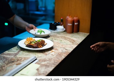 Badung, Bali Indonesia - March 13, 2019 : Chef is preparing foods for dinner