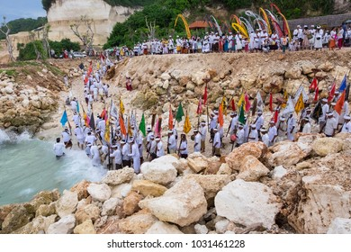 Badung, Bali, Indonesia - March 6th 2016 : Balinese people were bringing umbul-umbul flag to go to the Melasti beach in melasti day