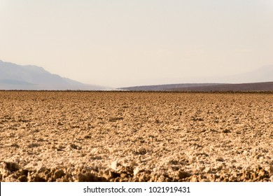 Badwater Basin, 282 feet / 85,5 meters below sea level. Dry salty desert, air is waving over the ground, soft bokeh, Death Valley National Park, California, USA,