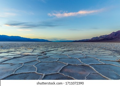 Badwater Basin at Sunset. Salt Crust and Clouds Reflection. Death Valley National Park. California, USA - Shutterstock ID 1711072390