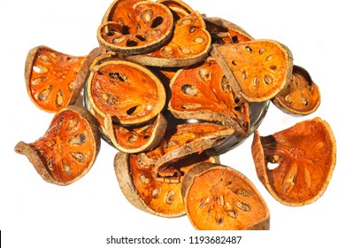 Bael Aegle marmelos. Dry bael fruit isolated on white background.Dried herbs and dried bael fruit drink Healthy and Natural Food concept