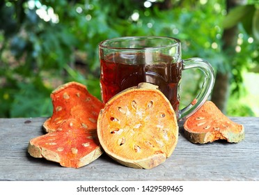 Bael fruit drink with dried bael in pieces