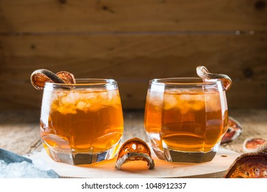 Bael juice ice tea on wooden table background , healthy drink