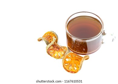 Bael tea juice and Dry Bael slices fruit on bamboo placemats background.