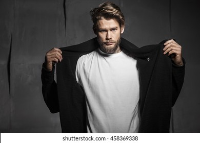 Baerded man in white t-shirt on grey background