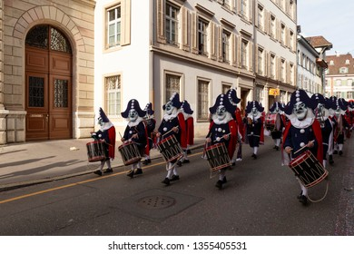 Baeumleingasse, Basel, Switzerland - March 12th, 2019. Carnival marching group with snare drums