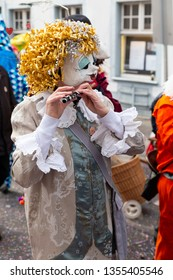 Baeumleingasse, Basel, Switzerland - March 12th, 2019. Close-up of a disguised carnival piccolo player