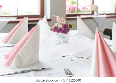 Baeutiful wedding decoration. Violet flowers and decoration for wedding