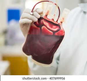Bag of Blood in hand asian Doctor