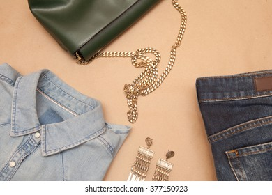 Bag and clothes on a beige background