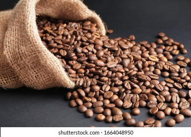 Bag with coffee beans on dark background