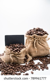 bag of coffee beens on white background