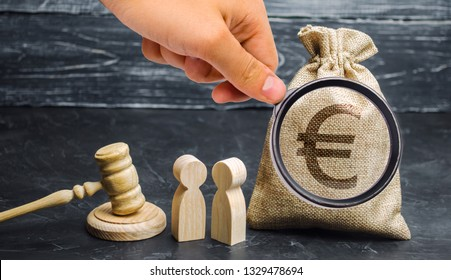 Bag with a euro sign, people and gavel. The concept of business conflict. Dispute between two businessmen. The division of property and divorce. Non-payment of debt. Alimony. Debt restructuring