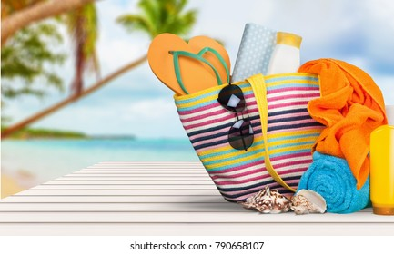 Bag,  flip flops on a tropical beach
