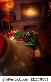 bag of gifts and Santa Claus in Santa's hut