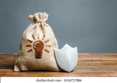 A bag with ideas or patents and a shield. The concept of protection of copyright and patents for inventions. Non-disclosure agreement. trade secrets and industrial espionage. Technology Abduction