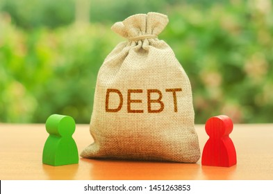 A bag with the inscription DEBT stands between two figures of people. Unclosed obligations between two persons, financial or moral debt. refusal to return debts. redemption and restructuring