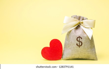 Bag with money and red heart. Valentine's Day. Saving money. Accumulation. Buying gifts to your loved one. Preparation for the holiday.