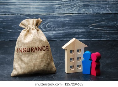 A bag with money and the word Insurance and the family standing near the house. Life insurance, health, family. Medical protection. The accumulation of money. Accumulation. Health care
