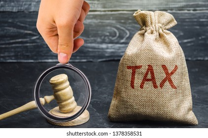 Bag of money and the word Tax and hammer of the judge. Law concept. Court and judgment. Justice and legality. Legislators, public administration. Property tax, house. Failure to pay taxes
