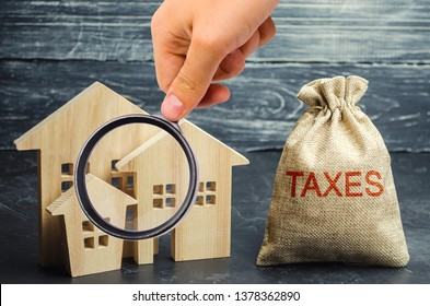 Bag with the money and the word Taxes and wooden houses. Taxes on real estate, payment. Penalty, arrears. Register of taxpayers for property. Law-abiding, evasion of payment. Court law. Luxury tax.