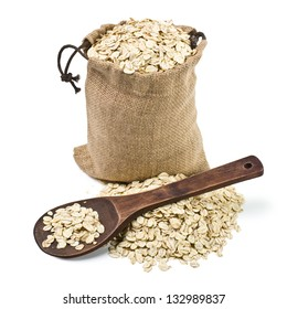 bag of oats and a wooden spoon on a white background. keeping paths