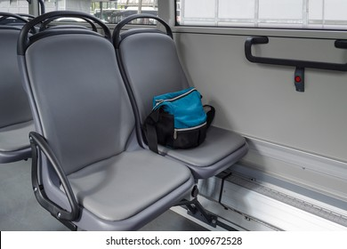 a bag on the seat in bus