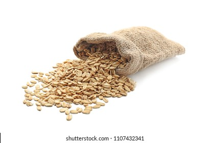 Bag with raw oatmeal on white background