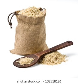 bag of rice and a wooden spoon on a white background. keeping paths