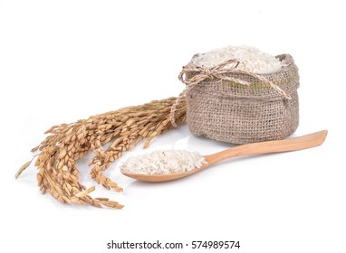 bag of rice and a wooden spoon on a white background keeping paths