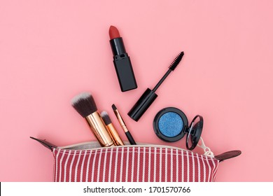 Bag set decorative cosmetics on pink and white