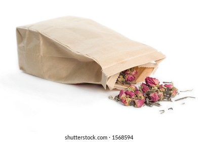 Bag of tea with tea spilled out.  Isolated on white.