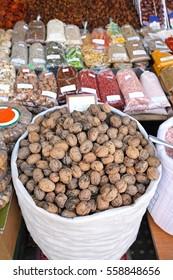 Bag of Walnuts in Shells at Farmers Market