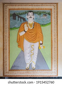Bagalkot, Karnataka, India - November 8, 2013: Sri Sangameshwar Temple. Portrait painting of guru Basavanna with immage of the property and the river in back.