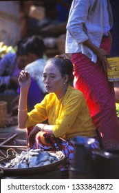BAGAN, BURMA - DEC 4, 1987 - Tribal woman with cheroot selling fish in market of Bagan,Burma - Myanmar, Asia