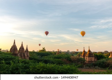 BAGAN, MYANMAR - 06 DECEMBER, 2018: Horizontal picture of scenic view of colorful sky with old buddhist temples and hot air balloons in Bagan, located in Myanmar
