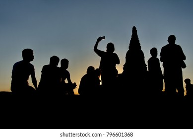 Bagan. Myanmar. 11/24/2016. Every night at sunset hundreds of tourists from different countries rise to the top of many Buddhist temples to see the splendor of the sunset over the horizon.