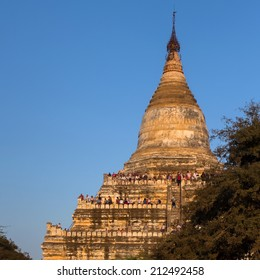 Bagan, Myanmar : 23 JAN 2013 Unidentify tourists climb to top of the pagoda to see the sunset.